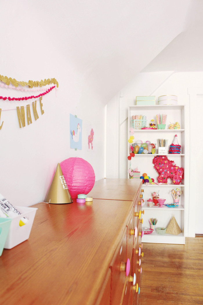 Bright & colorful craft room with painted turquoise fireplace